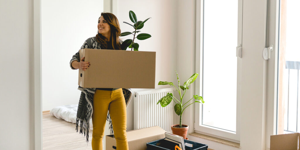 young woman moving into a new apartment